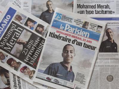 Französische Zeitungen mit dem Bild des Attentäters Mohamed Merah. Foto: Ian Langsdon/Archiv