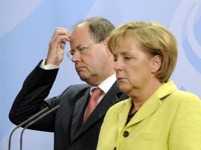 Peer Steinbrück und Angela Merkel im Herbst 2009. Eine Neuauflage der Koalition mit Merkel schließt Steinbrück aus. Foto: Rainer Jensen