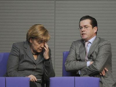 Angela Merkel und Karl-Theodor zu Guttenberg