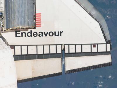 Schriftzug im Weltall: Insgesamt sind während der Abschiedsreise des Shuttles für die Astronauten vier Ausflüge ins All vorgesehen.