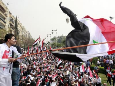 Anhänger des Assad-Regimes bei einer Demonstration in Damaskus. Foto: Youssef Badawi