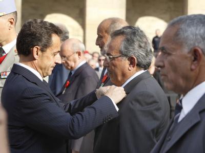 Präsident Sarkozy im September 2011 bei der Auszeichnung füherer