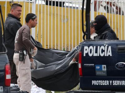 Mexikanische Ermittler am Ort eines Verbrechens. (Archivbild)