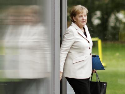 Bundeskanzlerin Angela Merkel verlässt die große Runde der Koalitionsverhandlungen - das war aber noch lange nicht die letzte Sitzung.