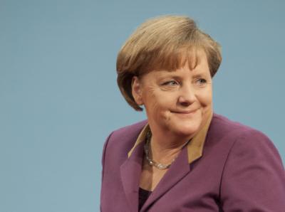 Angela Merkel bleibt zuversichtlich. Foto: Adrian Bradshaw/Archiv