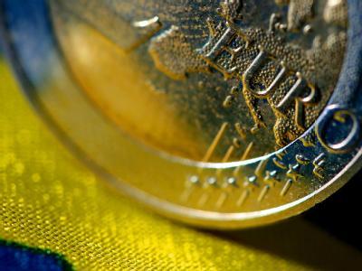 Euro-M�nze auf EU-Flagge