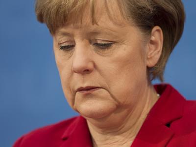 Kanzlerin Merkel muss eine herbe Niederlage für ihre Partei hinnehmen.
