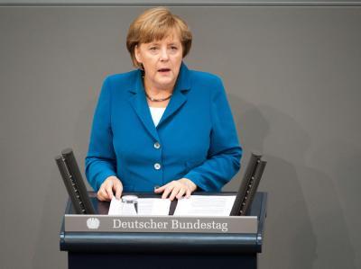 Kanzlerin Angela Merkel spricht im Bundestag. Foto: Maurizio Gambarini/ Archiv