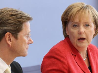 Kanzlerin Merkel und Außenminister Westerwelle wollen 80 Milliarden Euro sparen.