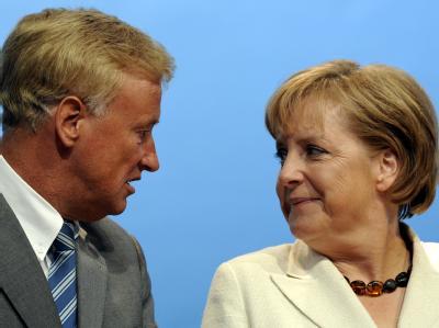 Merkel und Beust