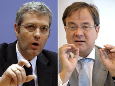 Bundesumweltminister Norbert Röttgen (l) will im Machtkampf um die Spitze der nordrhein-westfälischen CDU gegen Armin Laschet antreten.