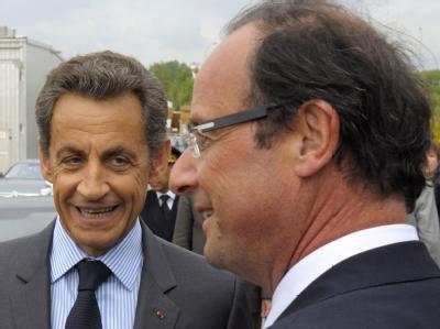 Sich in Umfragen hart auf den Fersen: Frankreichs Präsident Sarkozy und sein sozialistischer Herausforderer, Francois Hollande. Foto: Philippe Wojazer