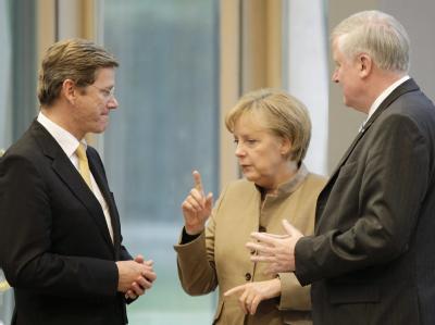 FDP-Chef Westerwelle, Bundeskanzlerin Merkel und der CSU-Vorsitzende Horst Seehofer.