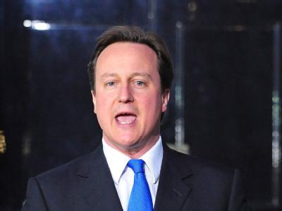 Ungewohnte Koalition: Der britische Premier David Cameron ruft die Regierung zum Zusammenhalt auf.