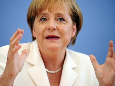 Bundeskanzlerin Angela Merkel stimmt die Bürger auf unangenehme Entscheidungen ein.