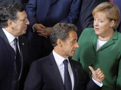 Jose Manuel Barroso, Nicolas Sarkozy und Angela Merkel beim EU-Sondergipfel in Brüssel.