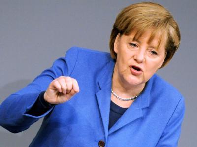 Bundeskanzlerin Angela Merkel gibt im Bundestag eine Regierungserklärung zur Lage in Japan ab.