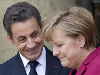 Bundeskanzlerin Merkel mit dem französischen Präsidenten Nicolas Sarkozy bei dem Sondergipfel zur Militäraktion in Libyen.