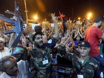 Libysche Rebellen feiern in Bengasi die Nachrichten aus der Hauptstadt.