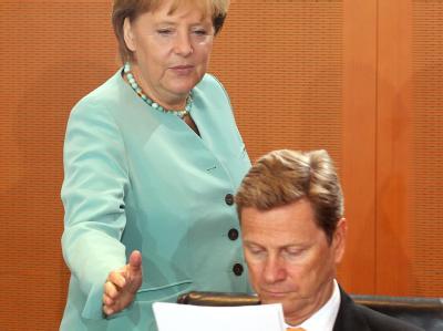Kanzlerin Angela Merkel (CDU) mit ihrem Bundesaußenminister Guido Westerwelle (FDP).