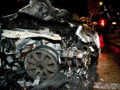 Reste eines ausgebrannten Autos in Berlin.