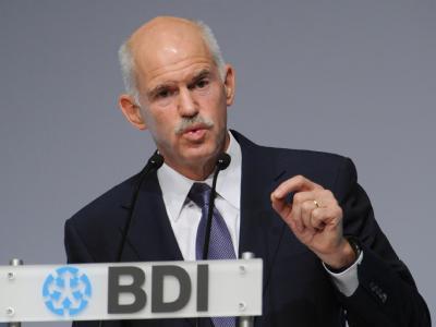 Der griechische Regierungschef Giorgos Papandreou verspricht bei einer Veranstaltung des Industrieverbandes BDI in Berlin die Sparzusagen einzuhalten. Archivfoto: Hannibal
