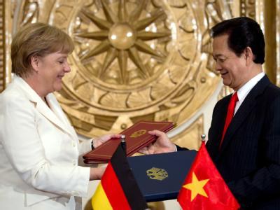 Bundeskanzlerin Angela Merkel und Vietnams Premierminister Nguyen Tan Dung. Foto: Michael Kappeler