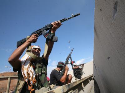 Gaddafi-Gegner während der letzten Kämpfe um die Stadt Sirte. Foto: Mohamed Messara