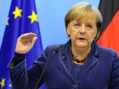 Kanzlerin Merkel am Ende einer langen Nacht in Brüssel. Foto: Benoit Dopagne