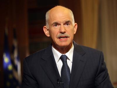 Der griechische Premierminister Giorgos Papandreou bei einer Fernsehansprache. Foto: EPA/VASSILIS FILIS / PRIME MINISTER PRESS OFFICE