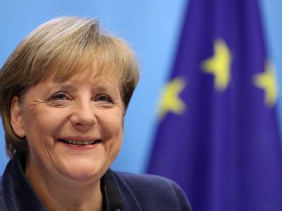 Strahlende Bundeskanzlerin: Euro-Staaten und Banken einigten sich auf einen teilweisen Schuldenerlass für Griechenland Foto: Oliver Berg