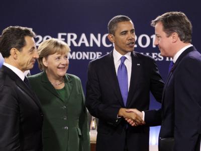 Frankreichs Präsident Sarkozy, Kanzlerin Merkel, US-Präsident Obama und Großbritanniens Premier Cameron auf dem G20-Gipfel in Cannes. Foto: Michel Euler