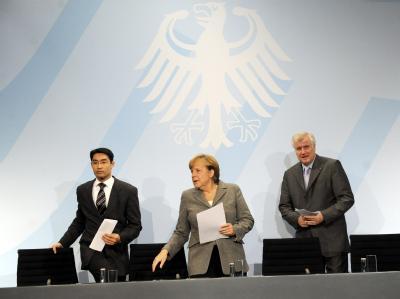 Philipp Rösler, Angela Merkel und Horst Seehofer im Bundeskanzleramt: Das Spitzentreffen hat endete mit einer Kompromisslösung. Foto: Maurizio Gambarini