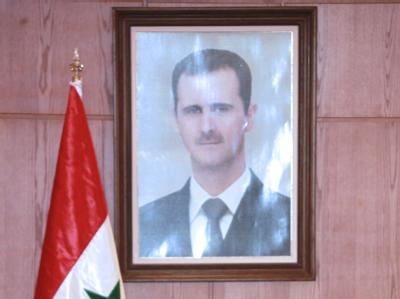 Verblasstes Porträt des syrischen Präsidenten Baschar al-Assad. Foto: Youssef Badawi