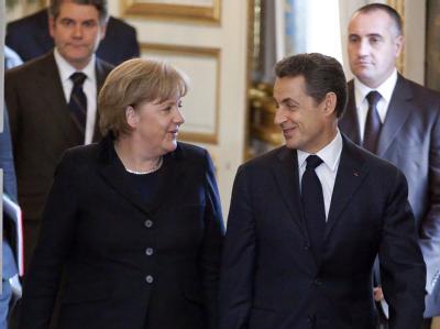 Mit einem unerwartet harten Aufschlag eröffnen Merkel und Sarkozy die neuerliche Euro-Rettungswoche. Sie gehen mit klaren Vorstellungen in den EU-Gipfel. Foto: Ian Langsdon