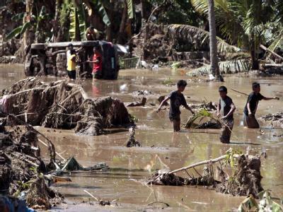 Durch den Tropensturm «Washi» sind auf den Philippinen mehr als 1000 Menschen ums Leben gekommen. Foto: Dennis M. Sabangan