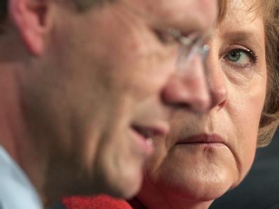 Christian Wulff und Angela Merkel. Foto: Johannes Eisele