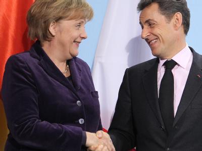 Bundeskanzlerin Merkel und der französische Staatspräsident Sarkozy haben in Berlin das weitere Vorgehen in der Eurokrise beraten. Foto: Wolfgang Kumm