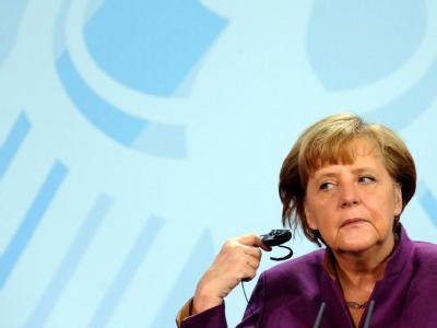 Steht in der Euro-Krise vor einer neuen Machtprobe. Einen noch größeren Rettungsschirm lehnt sie ab - doch wie lange?: Bundeskanzlerin Merkel. Foto: Maurizio Gambarini/Archiv