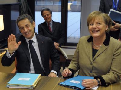 Kanzlerin Merkel und Frankreichs Präsident Sarkozy scheinen mit dem Ergebnis zufrieden. Foto: Philippe Wojazer