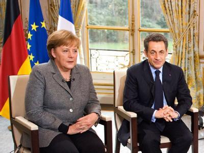 Bundeskanzlerin Angela Merkel und der französische Staatspräsident Nicolas Sarkozy bei einem interview im Elysee Palast in Paris. Foto: Jesco Denzel