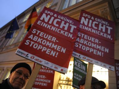 Campact-Aktivisten appellieren in Berlin: