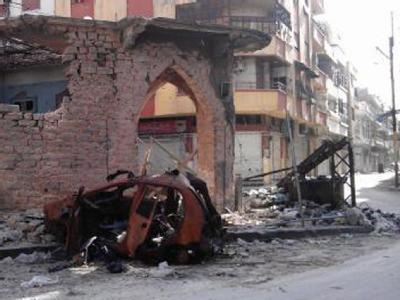Zerstörungen in Homs: Über 9000 Menschen sind nach Schätzungen bislang beim Aufstand gegen das Assad-Regime in Syrien getötet worden.  Foto: LOCAL COORDINATION COMMITTEES LCC