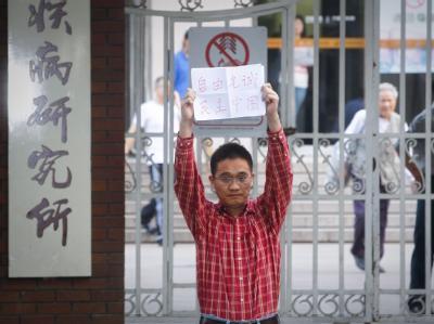 Protest gegen die Behandlung des blinden chinesischen Bürgerrechtlers Chen Guangcheng. Foto: Diego Azubel