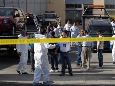Die zerstückelten Leichen von insgesamt 18 Menschen wurden in zwei Fahrzeugen im mexikanischen Bundesstaat Jalisco gefunden. Foto: Ulises Ruiz Basurto