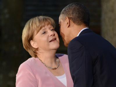 Begrüßung in Camp David: Barack Obama heißt Angela Merkel willkommen. Foto: Michael Reynolds
