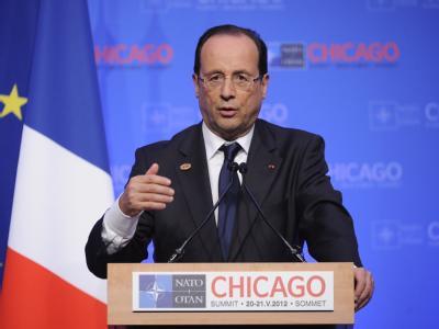 Francois Hollande präsentiert die Ergebnisses des Gipfels aus seiner Sicht. Foto: Yoan Valat