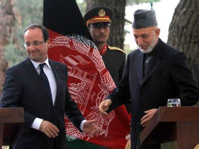 Frankreichs neuer Präsident François Hollande bei einer gemeinsamen Pressekonferenz mit dem afghanischen Präsidenten Hamid Karsai. Foto: S. Sabawoon