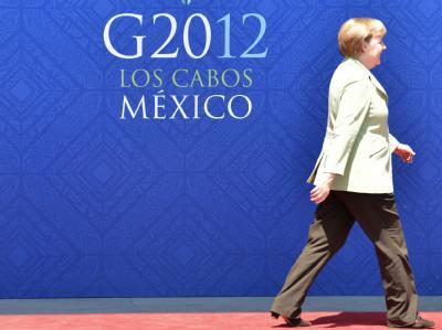 Allein gegen den Rest: Angela Merkel wehrt sich auch beim G20-Gipfel gegen Euro-Bonds, Schuldenprogramme und Abstriche bei Auflagen für Athen. Der internationale Druck wächst, die Kanzlerin bleibt stur. Foto: Peer Grimm
