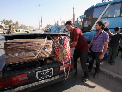 Flucht aus Syrien: Iraker, die vor der Gewalt aus ihrem eigenen Land geflohen sind, machen sich wieder auf die Suche nach einem sicheren Ort. Foto: Ali Abbas